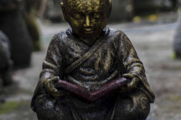 casting statue buddha reading
